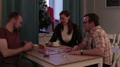 Men and woman play a board game in a cafe Stock Footage