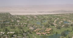 WS AERIAL View of suburb with golf course and elevated road Stock Footage