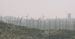 WS AERIAL ZO View of wind turbines in wind farm near mountain - stock footage