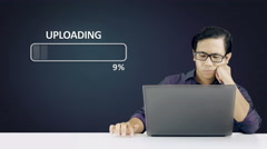 Asian Man Waiting Upload Process To Complete - 4K Resolution - stock footage