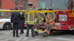 Police Line Tape Do Not Cross Officers Firemen Spectators Pan Stock Footage