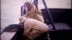 3271 crew brings in nets on commercial fishing vessel - vintage film home movie Stock Footage