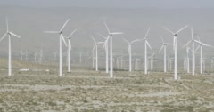 WS AERIAL ZO View of wind turbines in wind farm near mountain Stock Footage