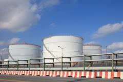 oil storage tank in heavy petrochemical industry estate - stock photo