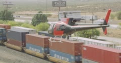 WS AERIAL TS View of helicopter moving above cargo train - stock footage