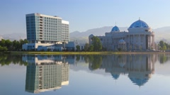 "Reflection of Teahouse ""Navruz"" and modern hotel in Dushanbe Stock Footage"