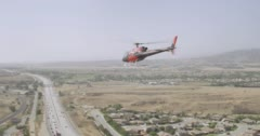 WS AERIAL TS View of helicopter moving above country road - stock footage