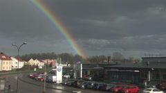 Double rainbow over a Swedish city Stock Footage