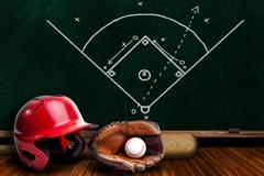 Baseball Equipment and Chalk Board Play Strategy - stock photo