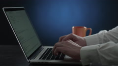 Hand print text on the keyboard and drink tea Stock Footage