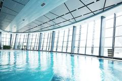 Design of swimming pool in modern gym Stock Photos
