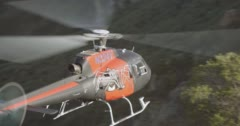 WS AERIAL Helicopter above built structure with graffiti - stock footage