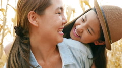 Asian girl with her mother enjoying in the meadow together, Slow motion shot - stock footage