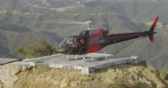 WS AERIAL ZI ZO Helicopter taking off from mountain top Stock Footage