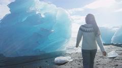 Iceland Jokulsarlon Iceberg beach - people walking by icebergs on Ice beach Stock Footage