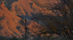 Texas Big Bend windmill in evening Sam Nail Ranch Stock Footage