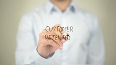 Customer Retention, man writing on transparent screen Stock Footage