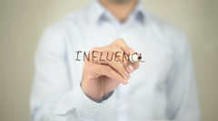 Influence, man writing on transparent screen Stock Footage