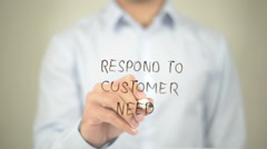 Respond to Customer Need, man writing on transparent screen - stock footage