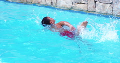 Child swimming with a red swimwear Stock Footage