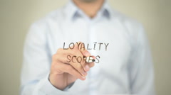 Loyality Scores, man writing on transparent screen Stock Footage