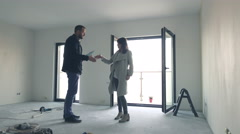 Real estate agent selling new home to man and shaking hands Stock Footage