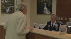 Patient Checking Into Hospital For Medical Procedure - stock footage