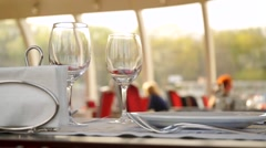 Table with wine glasses in river boat restaurant, Moscow river Stock Footage