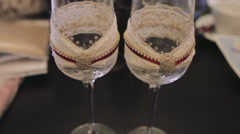 Two Empty Wine Glasses With Diamonds Stock Footage