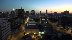 Texas Austin traffic on downtown street at sunset zoom in Stock Footage