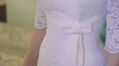 White Wedding Dress With Lace on the Bride - stock footage