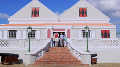 Tourist entering into The Curacao Museum, Willemstad, Curacao Stock Footage