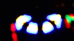 Arrow symbol defocused bokeh lights flickering vivid colors Stock Footage