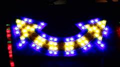 Arrow symbol lights flickering vivid colors Stock Footage