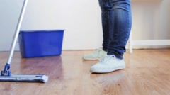 Woman with mop cleaning floor at home Stock Footage