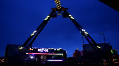 Fun Fair  huge scary fairground attraction at night flickering lights Stock Footage