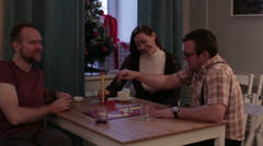Happy people play a board game in a cafe - stock footage