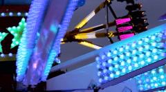 Fun Fair fairground attraction at night flickering lightsts - stock footage