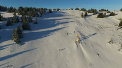 Aerial: camera following winter race runners climbing steep hill. Stock Footage