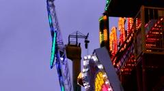 Fun Fair fairground attraction at night flickering lights - stock footage