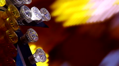 Close up yellow Fun Fair at night flickering lights Stock Footage