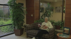 Patient Waiting For Exam In Hospital Lobby - stock footage