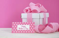 Happy Mothers Day white gift box with pink stripe ribbon. Stock Photos