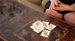 Close up on an elderly woman's hands shuffling playing cards on the table Stock Footage