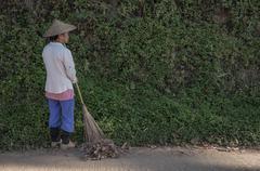 Pang-ung,  Mae Hong Son, THAILAND - Feb 12: Women rake collects leaves at Pan - stock photo