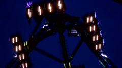 Fun Fair at night flickering lights Stock Footage