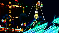 Fun Fair at night moving attraction - stock footage