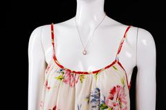 Floral pattern sarafan and necklace. - stock photo