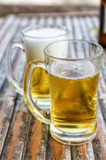Two beers in glasses - stock photo