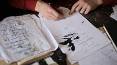 Artist is writing a letter Stock Footage
